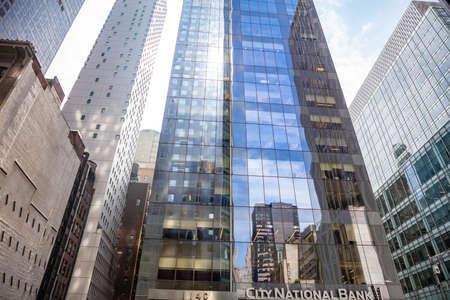 New York, USA. May 2nd, 2019. City National Bank glass building facade background, Manhatan