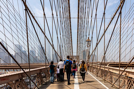 USA, New York. May 4, 2019. City view from Brooklyn bridge. People walking. Sunny day in the springtime Editorial