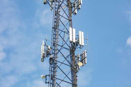Communication tower. 5G or 4G cell phone and wireless internet network against blue sky background