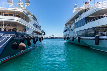 April 29, 2019. Marina Zeas in Piraeus, Greece. Luxury yachts moored at harbor ready to sail. Blue sky and sea background, space.