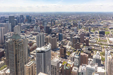 Chicago cityscape aerial view, spring day. High rise buildings, blue cloudy sky background. High angle view from skydeck