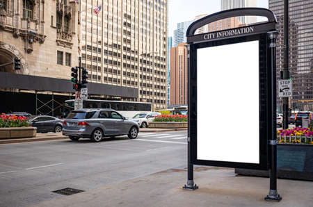 Blank white ad billboard at bus stop for advertising, Chicago city buildings and street background. Copy space