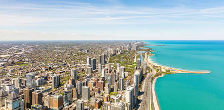 Chicago panorama. Cityscape aerial view, spring day. High rise buildings and lake Michiganl, blue sky background. High angle panoramic view from skydeck, banner