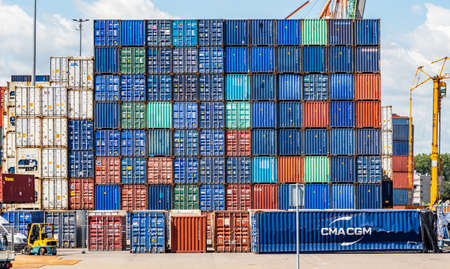 Rotterdam harbor, Netherlands. July 2nd, 2019. Logistics business. Stacked containers, and machinery, international port of Rotterdam, sunny summer day
