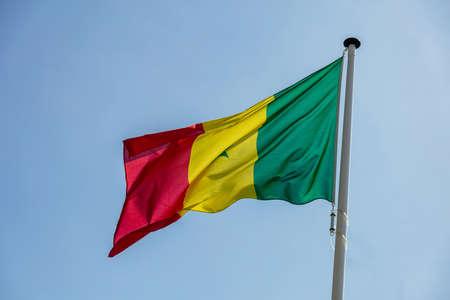 Senegal flag, National symbol waving against clear blue sky, sunny day Banco de Imagens