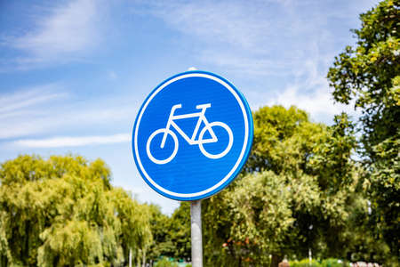 Bicycles lane sign, White bike icon on round blue color sign. Dutch road sign, Rotterdam Netherlands