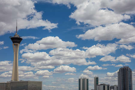 Las Vegas sky in a spring day. Skyscrappers upper part and tower against blue sky with clouds background, Nevada state, US of America 版權商用圖片