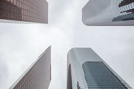 Los Angeles city skyscrapers, cloudy sky background, perspective low angle view