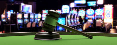 Casino and law concept. Judge gavel on green felt roulette table, blur slot machines room background, banner. 3d illustration