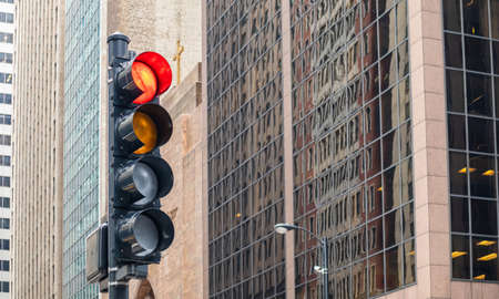 Stop sign. Red traffic lights for cars, office high rise buildings background, Chicago city, Illinois downtown