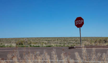Stop road sign, desert landscape. Sunny spring day in western USA countryside, copy space.