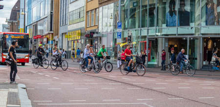 Utrecht Netherlands. July 1st, 2019. People riding bikes in the city center, Spring sunny day