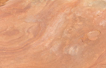 Red sandstone rock background, texture. closeup view, full background. Canyon de Chelly, Arizona USA