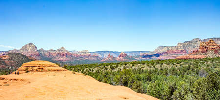 Sedona Arizona southwest US of America. Panoramic view of red orange color rock formations, desert sandstone landscape, clear blue sky, sunny spring day Imagens