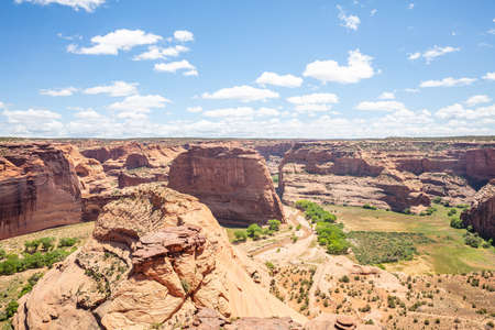 Canyon de Chelly national monument, Navajo nation. Arizona, US of America. Overlook of the sandstone formations in a sunny spring day, blue sky with clouds
