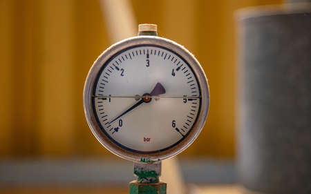 High pressure manometers, pipelines and valves, blur industrial background