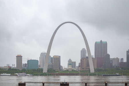 Saint Louis skyline. Gateway arch and Kiener Park, Missouri, US of America, cloudy spring day.