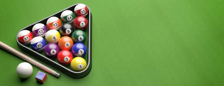 Billiard table, pool balls set in a triangle shape rack on green felt, banner, high angle view, copy space. 3d illustration