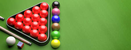 Snooker billiard table, pool balls set in a triangle shape rack on green felt, banner, high angle view, copy space. 3d illustration