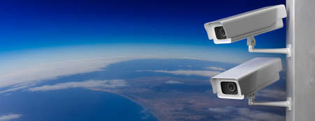 Surveillance CCTV Cameras. Security cam outdoors against earth curvature background, banner, copy space. 3d illustration