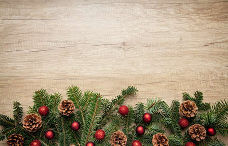 Christmas decoration. Fir tree twig fresh decorative garland against wood natural background, top view, copy space