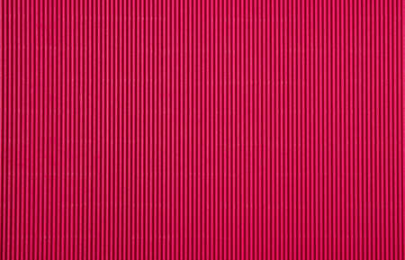 Corrugated cardboard paper magenta color background and texture, copy space.