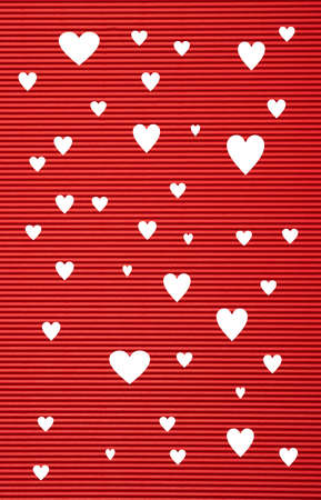 Valentines  day concept. Red color corrugated cardboard paper and white hearts background and texture