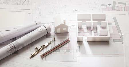 Residential building project architectural design, blueprint plans and house model, banner Foto de archivo