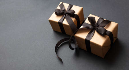 Black Friday sale concept. Gift boxes with black ribbon isolated against black background, high angle view 版權商用圖片 - 134777786