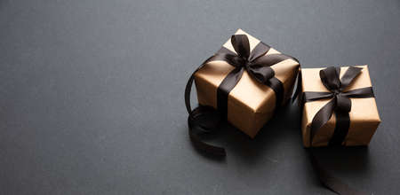 Black Friday sale concept. Gift boxes with black ribbon isolated against black background, high angle view 版權商用圖片
