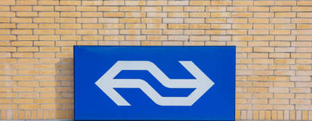 Eindhoven, Netherlands. October 10, 2019. NS railway sign at Eindhoven railway station building facade, Holland Editorial