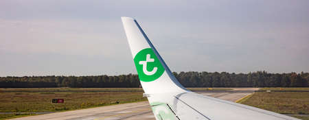 Eindhoven Netherlands. October 14, 2019. Transavia logo on a plane wing at Eindhoven airport. View out of airplane window.