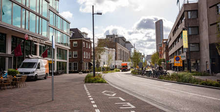 Eindhoven, Netherlands. October 10, 2019. NH Collection and modern or classic buildings located at Vestdijk street. Roads without traffic and bikes parked in the traffic island.