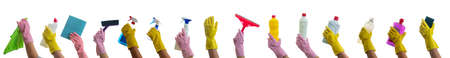 Cleaning, hand holding cleaning products and accessories isolated against white background. Cleaner rubber glove with cleaning supplies collage. Zdjęcie Seryjne