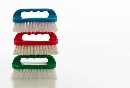 Cleaning brushes isolated against white background. Plastic brushes vibrant colors, hand tools, household cleaning supplies, copy space