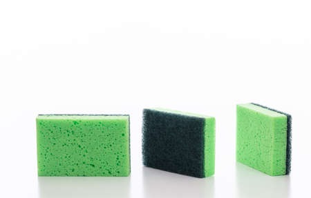 Cleaning kitchen sponges isolated against white background. Green color sponges for dish washing, household supplies