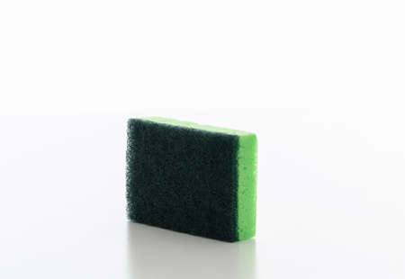 Cleaning kitchen sponge isolated against white background. Green color sponge for dish washing, household supplies