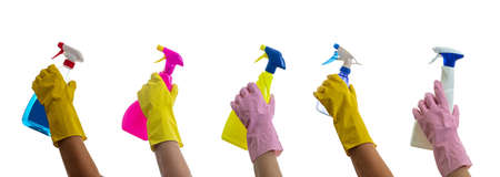 Cleaning, hand holding spray bottles isolated against white background. Cleaner rubber glove with chemical detergents sprayers collage.