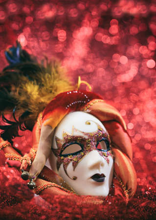 Carnival mask female theatrical face against red bokeh background. Mardi gras party celebration, theatrical costume concept Zdjęcie Seryjne