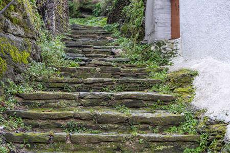 Greece, Tzia Kea island. Ioulis capital town narrow street with stairs and traditional stone walls
