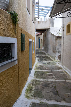 Traditional greek whitewashed buildings and narrow cobblestone streets in Ioulida village, Chora.