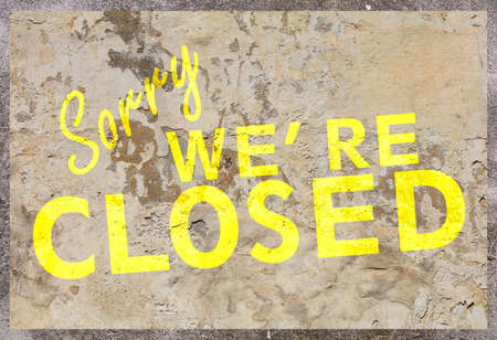 Closed sign. Yellow color text Sorry we re closed on beige marble stone background, Information about closed business or store concept.