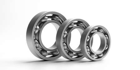 Ball bearings. Steel metal industrial spare parts, various sizes isolated on white background. Machinery, engine mechanism, engineering concept. 3d illustration Standard-Bild