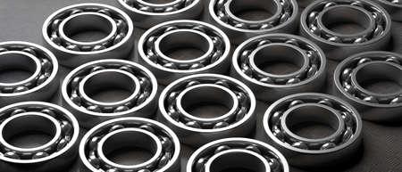 Ball bearings. Steel spare parts on industrial black metal sheet background. Machinery, engine mechanism, engineering concept. 3d illustration Standard-Bild