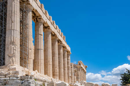 Athens Acropolis, Greece top landmark. Parthenon temple facade side view, ancient temple ruins, blue sky background in spring sunny day. Stock Photo