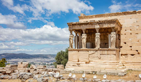 Athens Acropolis, Greece landmark. Erechtheion, Erechtheum, Temple of Athena with Caryatid Porch, Ancient Greek ruins, blue sky in spring sunny day.