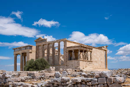 Athens Acropolis, Greece landmark. Erechtheum, Erechtheion Temple of Athena with Cariatides Porch, Ancient Greek ruins, blue sky in spring sunny day.