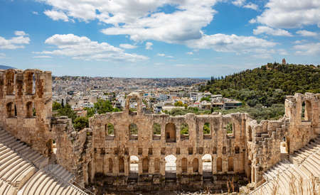 Herodes Atticus Odeon, Herodium ancient theater under the ruins of Acropolis, Greece, overlooking Athens city, sunny spring day, blue sky