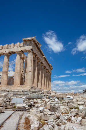 Athens Acropolis, Greece top landmark. Parthenon temple dedicated to goddess Athena, ancient temple ruins, blue sky background in spring sunny day, vertical photo.