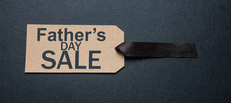 Fathers day SALE, Special offer sale. Promotion and shopping template for fathers day. Text on kraft paper tag label, black background.